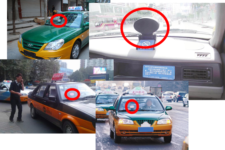 Official taxis with indicator lights in the front window.